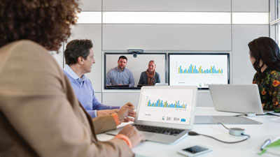 3 people having a virtual meeting with 2 people on the computer screen